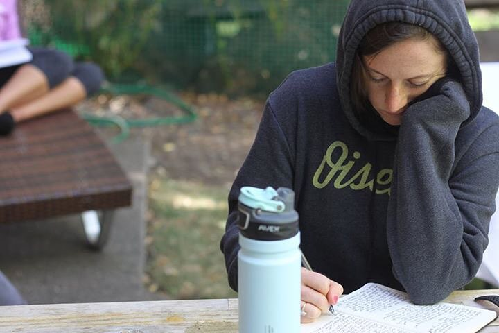 Elizabeth Carey writing at Wilder Running retreat. Photo: Jess Barnard